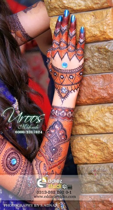 Beautiful-Eid-Mehndi-Designs For-Hand-Feet-Arabic-Henna-Mehndi-Designs-Bridal-Wedding-18